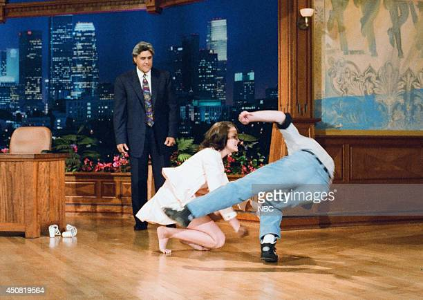 Host Jay Leno looks on as actress Katherine Heigl takes down an audience member on August 1 1995