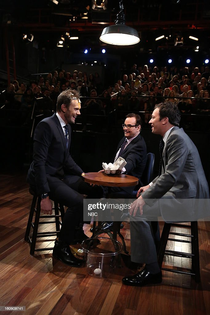 Joel McHale, Steve Higgins, host Jimmy Fallon during a skit on February 7, 2013 --