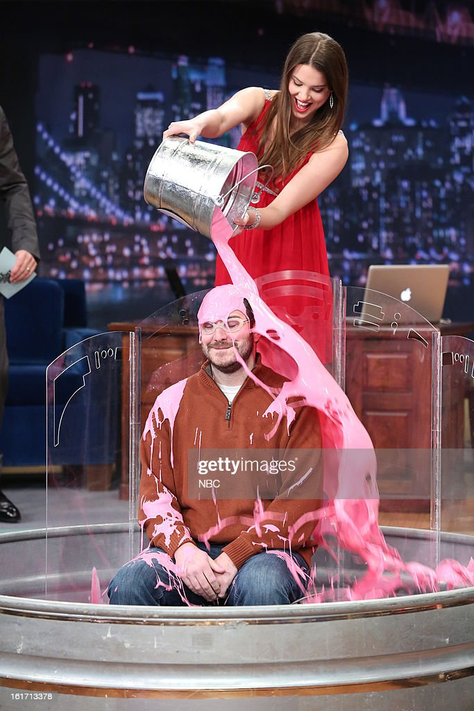 Host <a gi-track='captionPersonalityLinkClicked' href=/galleries/search?phrase=Jimmy+Fallon&family=editorial&specificpeople=171520 ng-click='$event.stopPropagation()'>Jimmy Fallon</a> with model and contestant during a skit on February 14, 2013 --