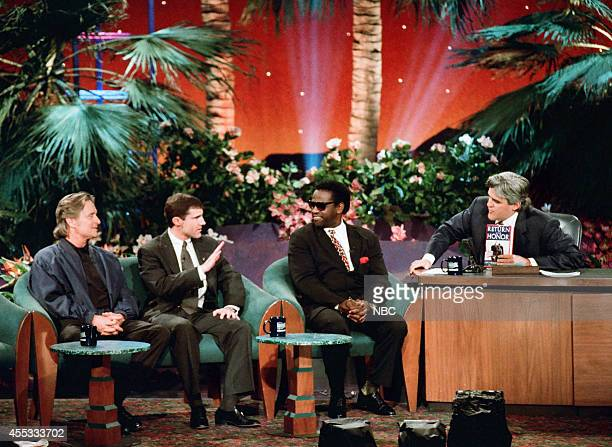 Actor Michael Douglas captain Scott O'Grady and musical guest Al Green during an interview with host Jay Leno on November 16 1995