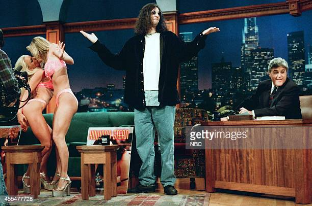 Adult film actresses Nikki Taylor and Janine Lindemulder and radio personality Howard Stern during an interview with host Jay Leno on November 30 1995