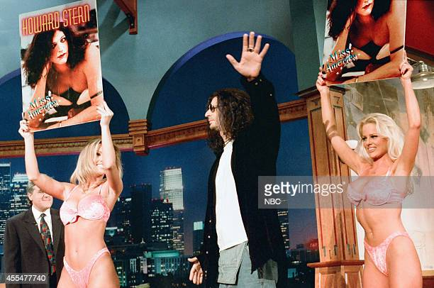 Radio personality Howard Stern arrives with adult film actresses Janine Lindemulder and Nikki Taylor on November 30 1995