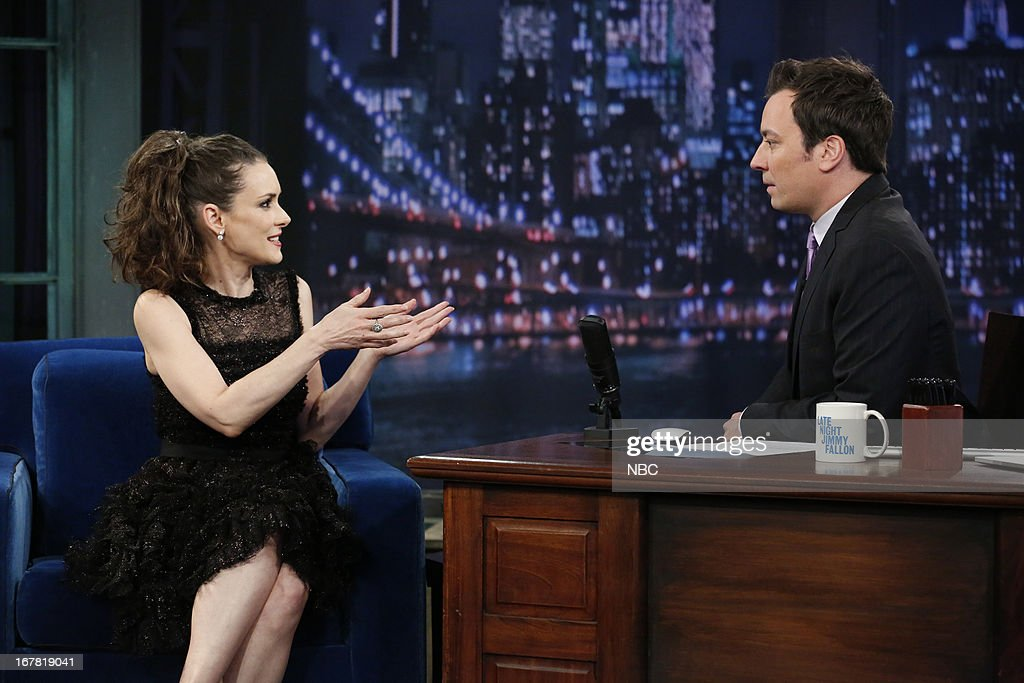 Actress <a gi-track='captionPersonalityLinkClicked' href=/galleries/search?phrase=Winona+Ryder&family=editorial&specificpeople=203145 ng-click='$event.stopPropagation()'>Winona Ryder</a> with host Jimmy Fallon during an interview on April 30, 2013 --