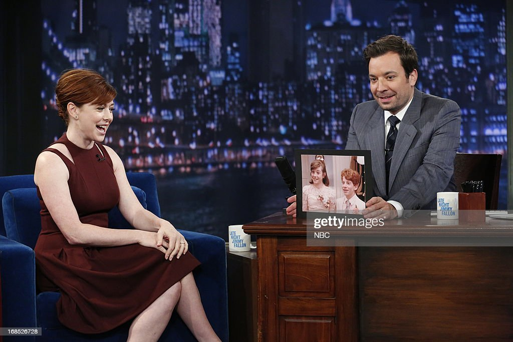 Actress <a gi-track='captionPersonalityLinkClicked' href=/galleries/search?phrase=Alyson+Hannigan&family=editorial&specificpeople=206497 ng-click='$event.stopPropagation()'>Alyson Hannigan</a> with host Jimmy Fallon during an interview on May 10, 2013 --