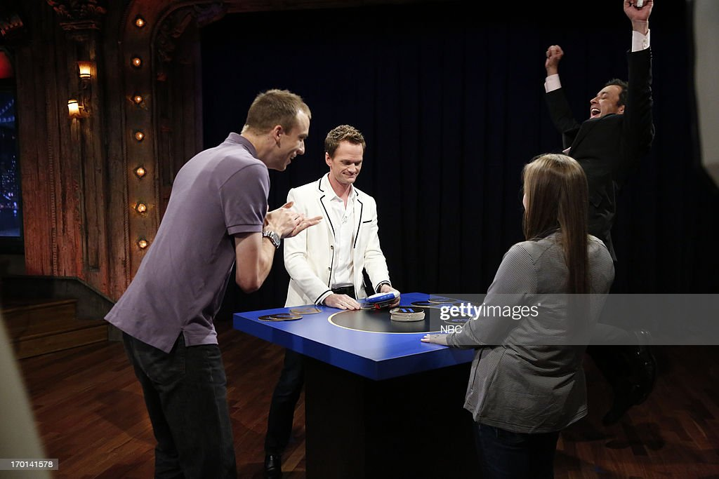 Neil Patrick Harris, host Jimmy Fallon and contestants during a game of 'Catch Phrase' on June 7, 2013 --