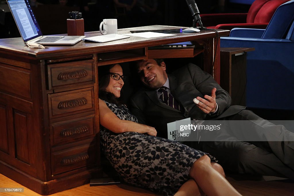 Actress Julia Louis-Dreyfus with host Jimmy Fallon during an 'Under The Desk' interview on June 13, 2013 --