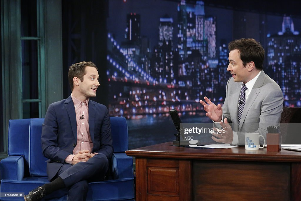 <a gi-track='captionPersonalityLinkClicked' href=/galleries/search?phrase=Elijah+Wood&family=editorial&specificpeople=171364 ng-click='$event.stopPropagation()'>Elijah Wood</a> with host Jimmy Fallon during an interview on June 20, 2013 --