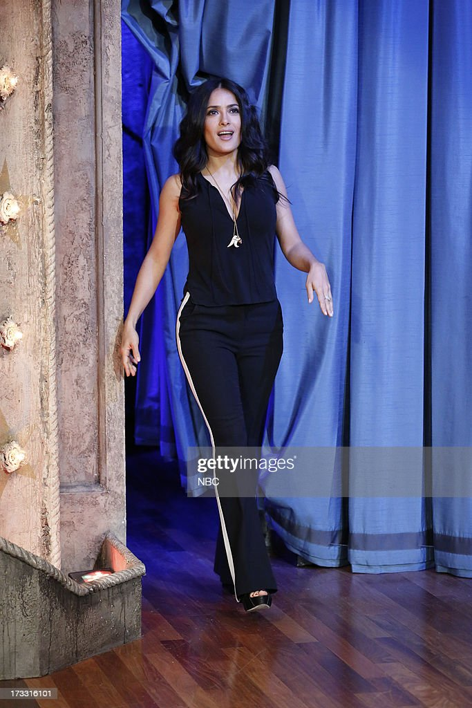 Actress <a gi-track='captionPersonalityLinkClicked' href=/galleries/search?phrase=Salma+Hayek&family=editorial&specificpeople=201844 ng-click='$event.stopPropagation()'>Salma Hayek</a> Pinault arrives on July 11, 2013 --