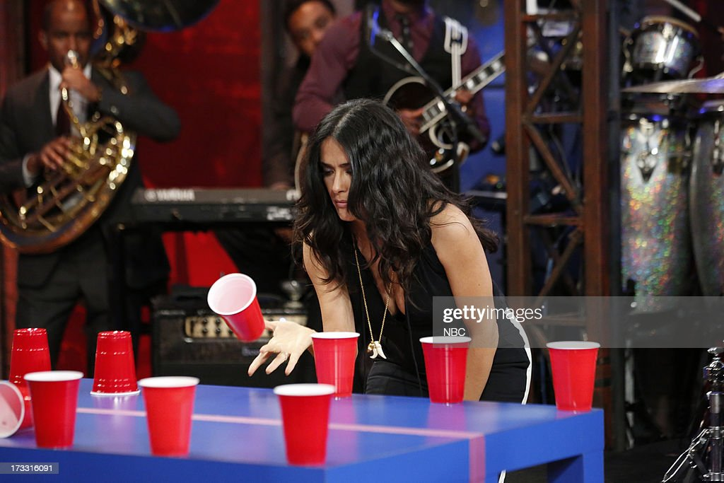 Actress <a gi-track='captionPersonalityLinkClicked' href=/galleries/search?phrase=Salma+Hayek&family=editorial&specificpeople=201844 ng-click='$event.stopPropagation()'>Salma Hayek</a> Pinault during a game of 'Flip Cup' on the July 11, 2013 --