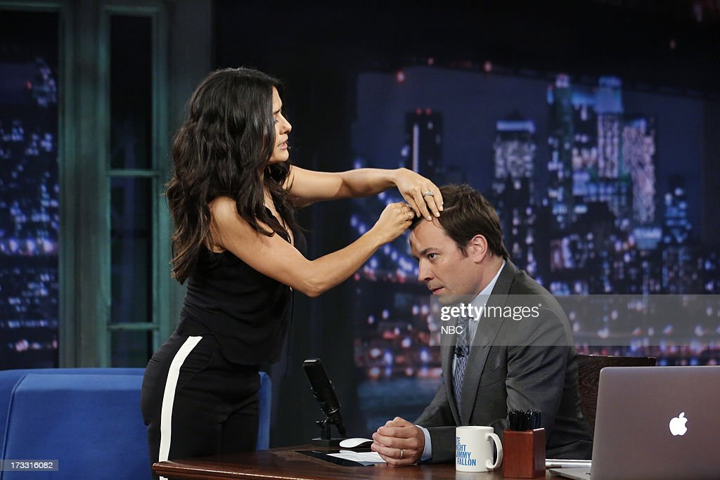 Actress <a gi-track='captionPersonalityLinkClicked' href=/galleries/search?phrase=Salma+Hayek&family=editorial&specificpeople=201844 ng-click='$event.stopPropagation()'>Salma Hayek</a> Pinault gives some hands on hair styling tips to host Jimmy Fallon during an interview on the July 11, 2013 --
