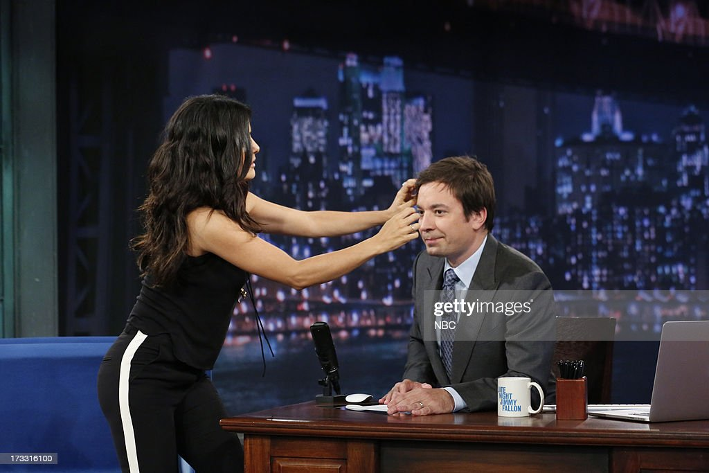 Actress Salma Hayek Pinault gives some hands on hair styling tips to host Jimmy Fallon during an interview on the July 11, 2013 --