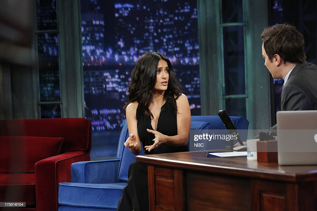 Actress <a gi-track='captionPersonalityLinkClicked' href=/galleries/search?phrase=Salma+Hayek&family=editorial&specificpeople=201844 ng-click='$event.stopPropagation()'>Salma Hayek</a> Pinault with host Jimmy Fallon during an interview on the July 11, 2013 --