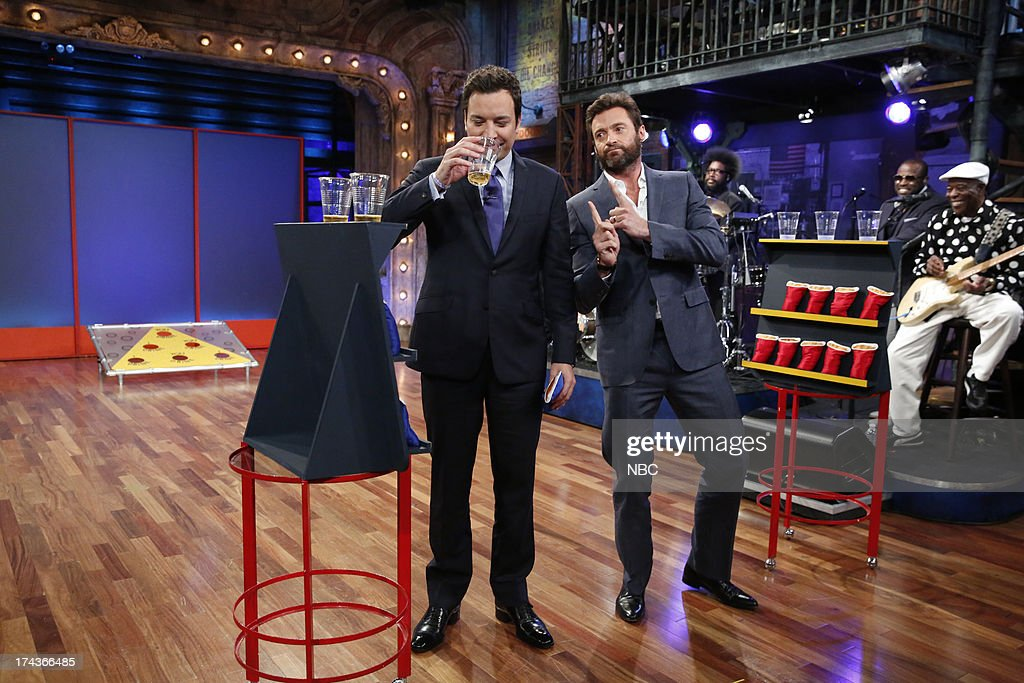 Host Jimmy Fallon with <a gi-track='captionPersonalityLinkClicked' href=/galleries/search?phrase=Hugh+Jackman&family=editorial&specificpeople=202499 ng-click='$event.stopPropagation()'>Hugh Jackman</a> during a drinking game on July 24, 2013 -- (Photo by: Lloyd Bishop/NBC/NBCU Photo Bank via Getty Images).