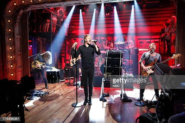 Musical guests Wayne 'Wing' Sermon Dan Reynolds Dan Platzman Ben McKee of Imagine Dragons perform 'Radioactive' on July 26 2013