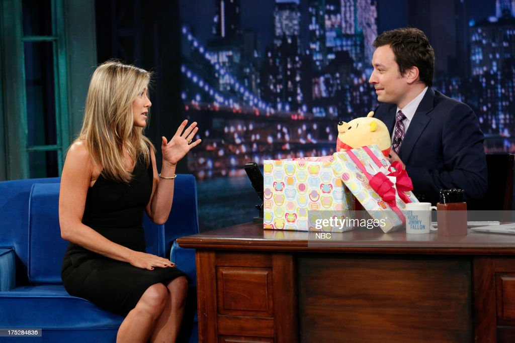 <a gi-track='captionPersonalityLinkClicked' href=/galleries/search?phrase=Jennifer+Aniston&family=editorial&specificpeople=202048 ng-click='$event.stopPropagation()'>Jennifer Aniston</a> gives host Jimmy Fallon a baby gift on August 1, 2013 --