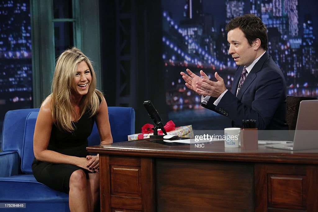 <a gi-track='captionPersonalityLinkClicked' href=/galleries/search?phrase=Jennifer+Aniston&family=editorial&specificpeople=202048 ng-click='$event.stopPropagation()'>Jennifer Aniston</a> with host Jimmy Fallon during an interview on August 1, 2013 --