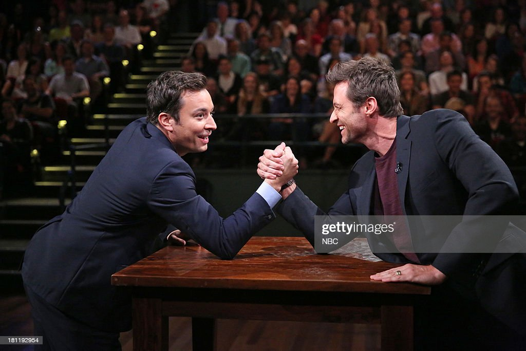Host Jimmy Fallon, actor <a gi-track='captionPersonalityLinkClicked' href=/galleries/search?phrase=Hugh+Jackman&family=editorial&specificpeople=202499 ng-click='$event.stopPropagation()'>Hugh Jackman</a> arm wrestle on September 19, 2013 --