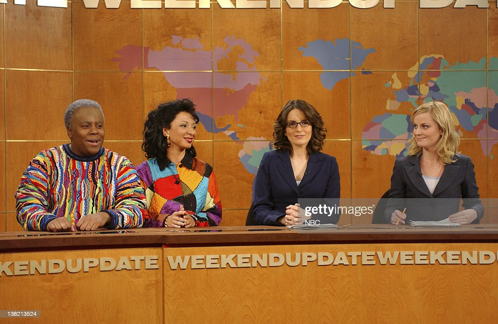 LIVE -- Episode 9 -- Aired -- Pictured: (l-r) Kenan Thompson as Cliff Huxtable, Maya Rudolph as Claire Huxtable, Tina Fey, Amy Poehler during 'Weekend Update'