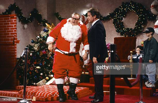 Chris Farley as Matt Foley Phil Hartman as manager during the 'Motivational Santa' skit on December 11 1993 Photo by Gene Page/NBC/NBCU Photo Bank