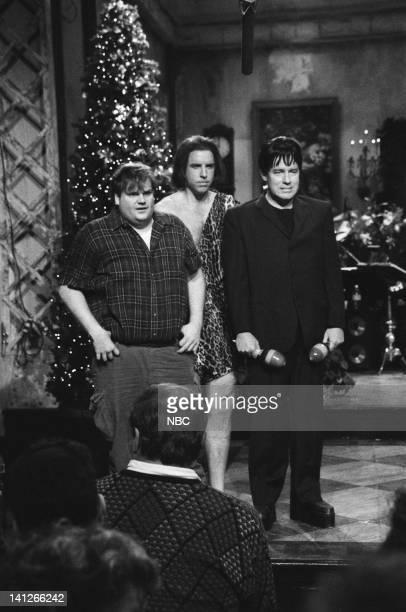 Chris Farley Kevn Nealon as Tarzan Phil Hartman as Frankenstein during 'Season's Greetings' skit on December 14 1991 Photo by Raymond Bonar/NBCU...