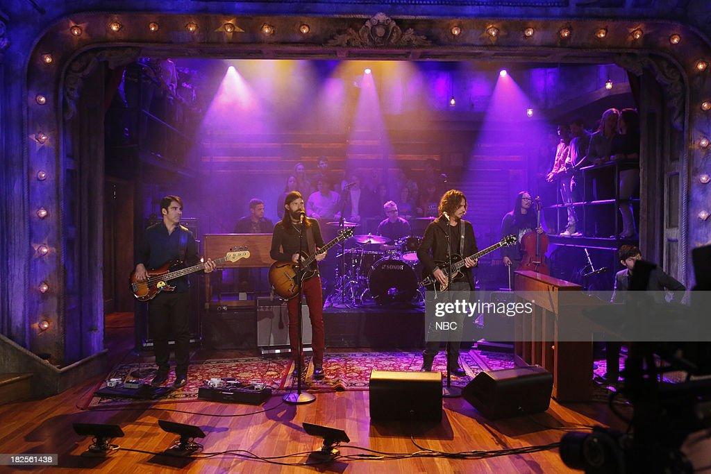 Bob Crawford, Paul DeFiglia, Seth Avett, Mike Marsh, Chris Cornell, Joe Kwon, Scott Avett of musical guest The Avett Brothers perform on September 30, 2013--