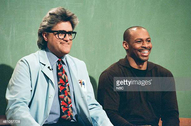 Host Jay Leno and The Tonight Show Band leader Kevin Eubanks during the 'Mr Brain' sketch on May 7 1996