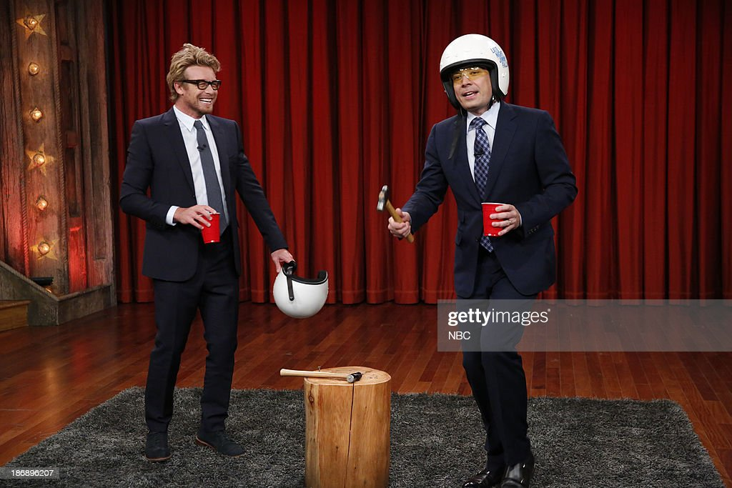 Actor <a gi-track='captionPersonalityLinkClicked' href=/galleries/search?phrase=Simon+Baker&family=editorial&specificpeople=206176 ng-click='$event.stopPropagation()'>Simon Baker</a> and Jimmy compete in the drinking game Stump on Monday, November 4, 2013 --