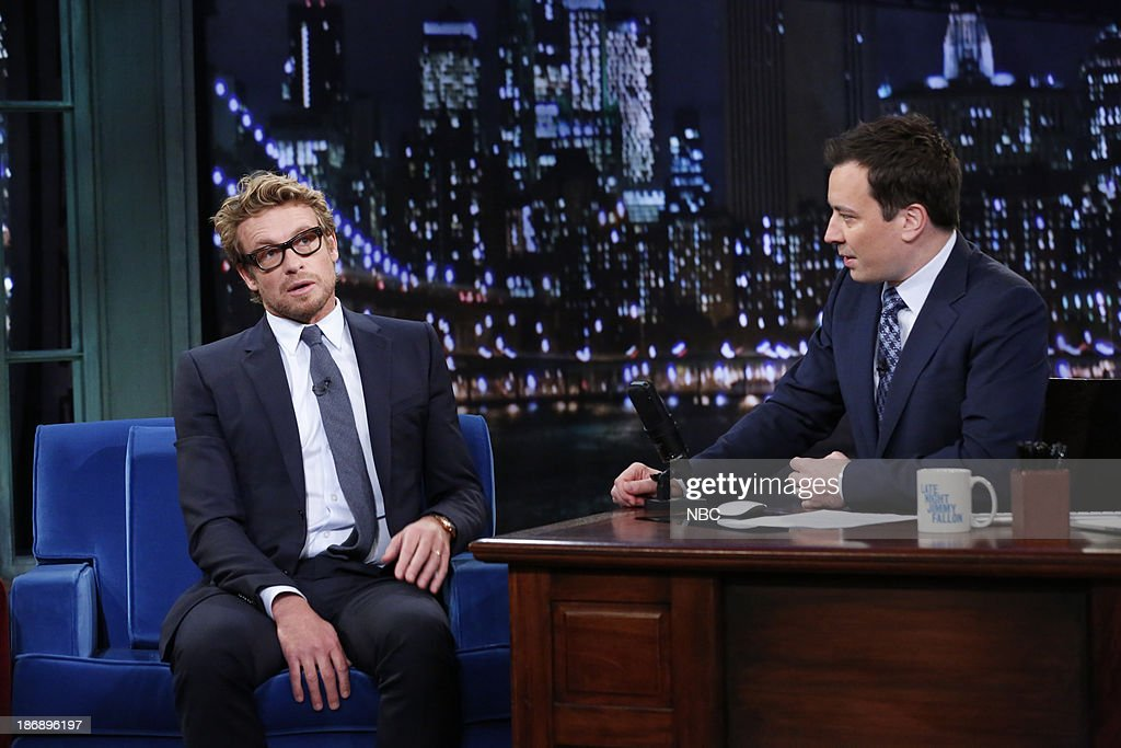 Actor <a gi-track='captionPersonalityLinkClicked' href=/galleries/search?phrase=Simon+Baker&family=editorial&specificpeople=206176 ng-click='$event.stopPropagation()'>Simon Baker</a> with host Jimmy Fallon during an interview on Monday, November 4, 2013 --