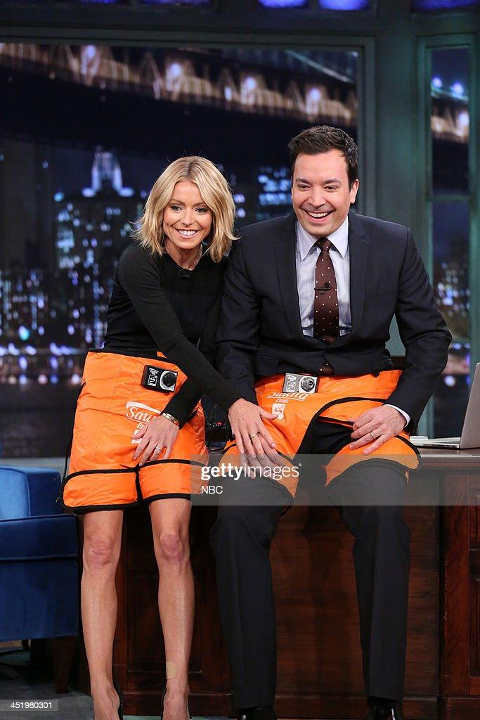 Kelly Ripa and Jimmy Fallon try out sauna pants on Monday, November 25, 2013 --