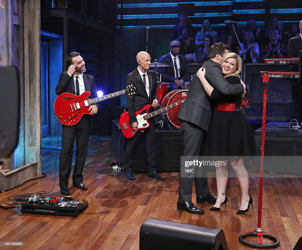 Host Jimmy Fallon hugs Music guest <a gi-track='captionPersonalityLinkClicked' href=/galleries/search?phrase=Kelly+Clarkson&family=editorial&specificpeople=201555 ng-click='$event.stopPropagation()'>Kelly Clarkson</a> on Tuesday, November 26, 2013 --