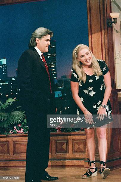 Host Jay Leno greets swimmer Susie Maroney as she delivers the headlines on June 17 1996