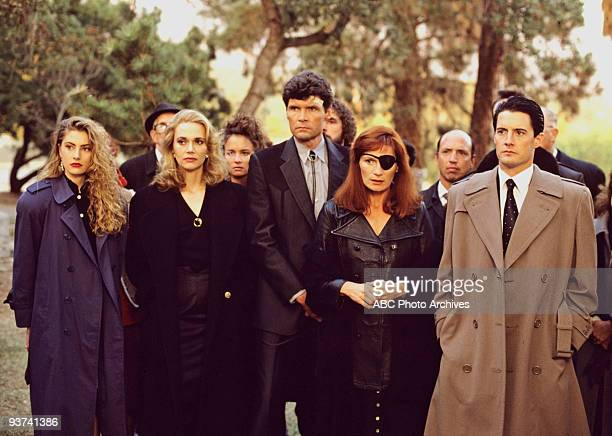 PEAKS Episode Three Season One 4/26/1990 FBI Special Agent Dale Cooper at former homecoming queen Laura Palmer's funeral with a lineup of...