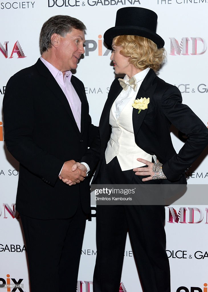 Epix CEO Mark Greenberg and Madonna attend the Dolce & Gabbana and The Cinema Society screening of the Epix World premiere of 'Madonna: The MDNA Tour' at The Paris Theatre on June 18, 2013 in New York City.