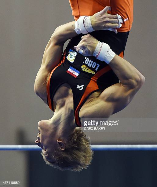 Epke Zonderland of Netherlands perfoms his routine in the men's horizontal bar final at the Gymnastics World Championships in Nanning in China's...
