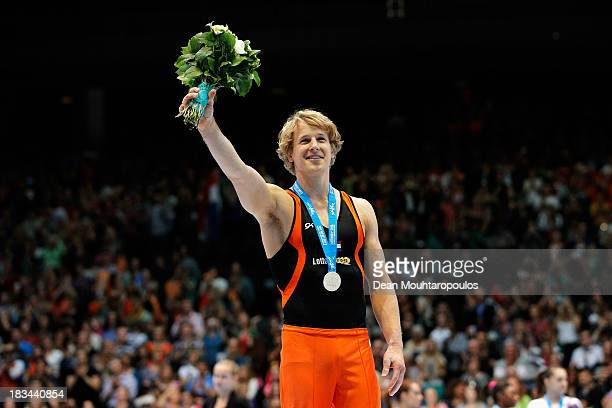 Epke Zonderland of the Netherlands celebrates with the gold medal after winning the Horizontal Bar Final on Day Seven of the Artistic Gymnastics...