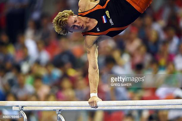 Epke Zonderland of the Netherlands competes on the parallel bars during the men's qualification at the Gymnastics World Championships in Nanning in...