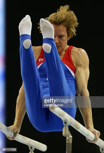 Epke Zonderland of the Netherlands competes on the Parallel bars during the 7th Doha Art Gymnastics World Cup at the Aspire Academy in the Qatari...