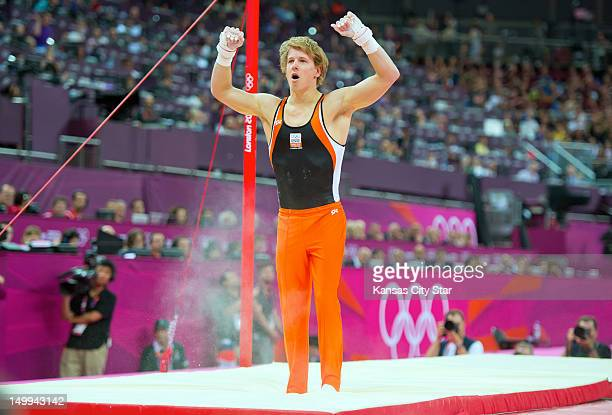 Epke Zonderland of the Netherlands reacted after his dismount of his gold medal performance in the men's horizontal bar apparatus finals at North...