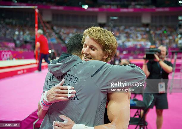 Epke Zonderland of the Netherlands right hugged Danell Leyva of the United States after Zonderland won the gold medal in the men's horizontal bar...