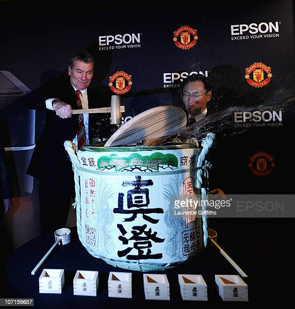 Epson Global President Mr Minoru Usui breaks a sake barrell with Manchester United Chief Executive David Gill during a Press Conference as Manchester...