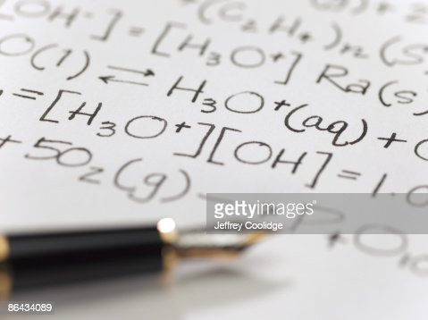 Equations on Paper with Pen : Stock Photo