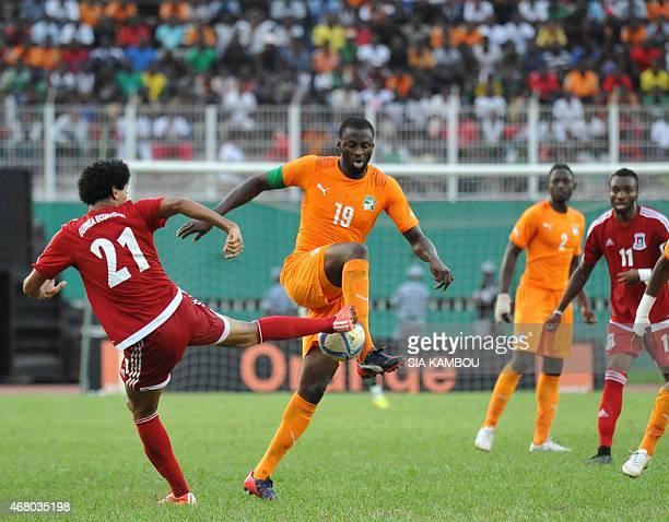 Equatorial Guinea's Ivan Zarandona vies with Ivory Coast's Yaya Toure during the friendly football match Ivory Coast againt Equatorial Guinea on...