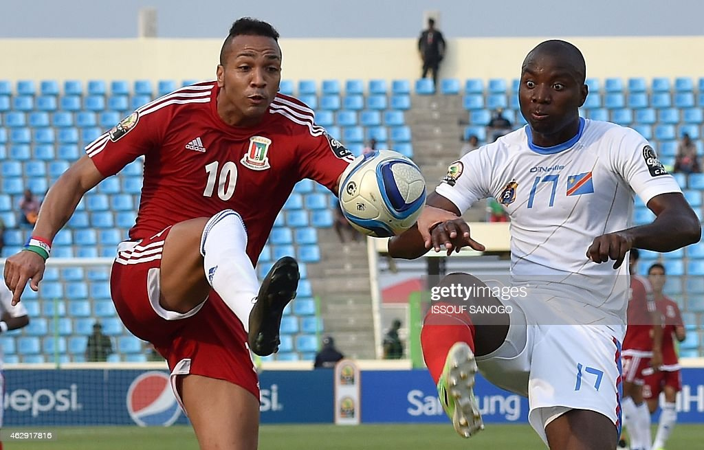 Equatorial Guinea's midfielder <a gi-track='captionPersonalityLinkClicked' href=/galleries/search?phrase=Emilio+Nsue&family=editorial&specificpeople=6331858 ng-click='$event.stopPropagation()'>Emilio Nsue</a> (L) challenges Democratic Republic of the Congo's defender <a gi-track='captionPersonalityLinkClicked' href=/galleries/search?phrase=Cedric+Mongongu&family=editorial&specificpeople=4305033 ng-click='$event.stopPropagation()'>Cedric Mongongu</a> during the 2015 African Cup of Nations third place play-off football match between Democratic Republic of the Congo and Equatorial Guinea in Malabo on February 7, 2015. AFP PHOTO / ISSOUF SANOGO