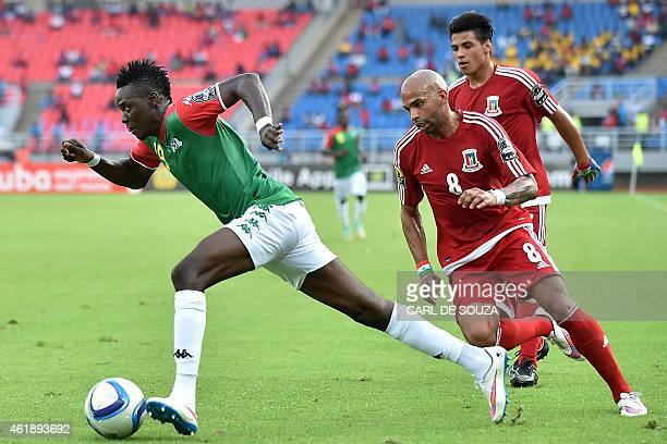 Equatorial Guinea's midfielder Randy challenges Burkina Faso's midfielder Bertrand Traore during the 2015 African Cup of Nations group A football...