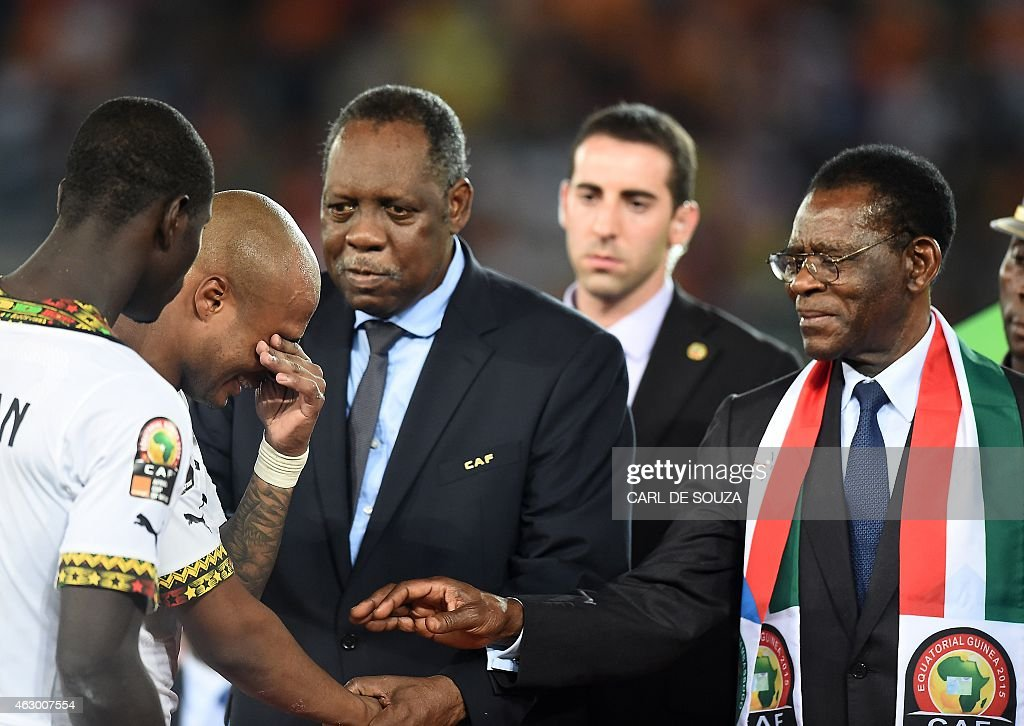 Equatorial Guinea's President Teodoro Obiang Nguema Mbasogo (R) and Confederation of African Football president Issa Hayatou try to console Ghana's midfielder Andre Ayew (2nd-L) as he cries after his team lost the 2015 African Cup of Nations final football match between Ivory Coast and Ghana in Bata on February 8, 2015.