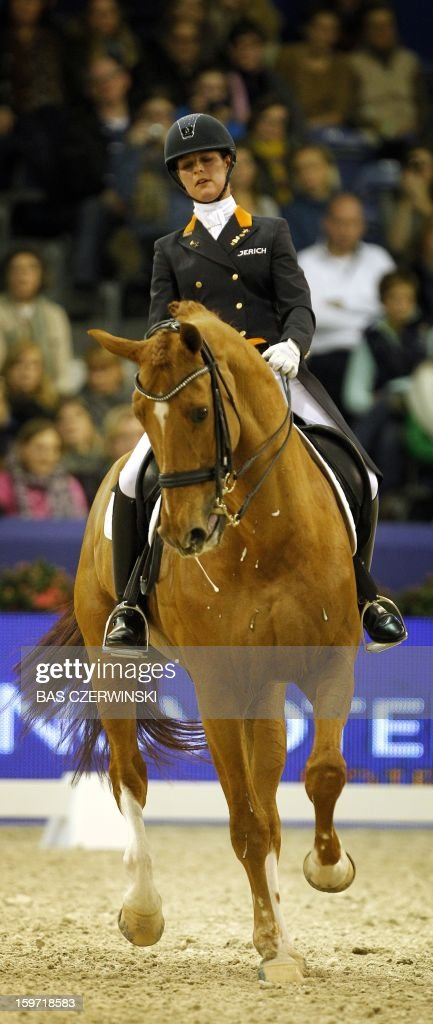 Equestrian <a gi-track='captionPersonalityLinkClicked' href=/galleries/search?phrase=Adelinde+Cornelissen&family=editorial&specificpeople=5427385 ng-click='$event.stopPropagation()'>Adelinde Cornelissen</a> of the Netherlands rides Jerich Parzival during the FEI World Cup dressage event at the Jumping Amsterdam 2013 competition, in Amsterdam, the Netherlands, on January 19, 2013.