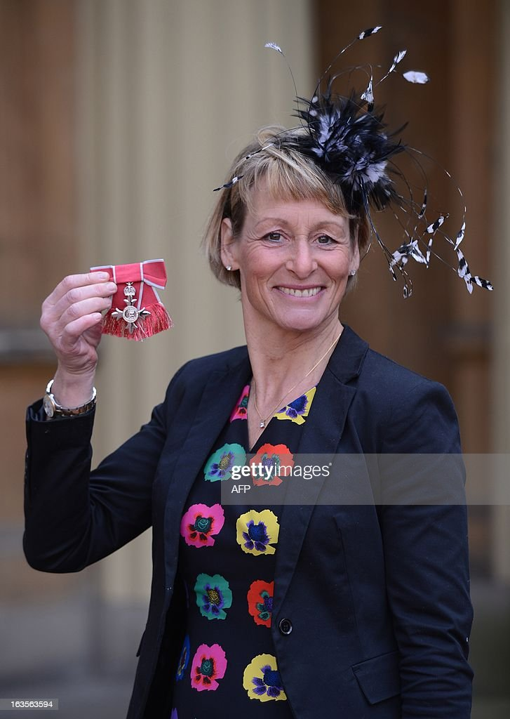 Equestrian and Olympian Mary King poses for photographs after she received an MBE at Buckingham Palace in London on March 12, 2013. AFP PHOTO/POOL/Stefan Rousseau