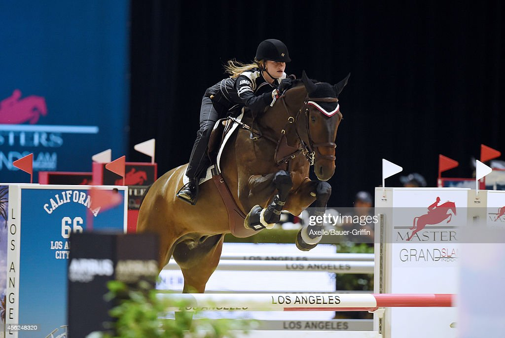 Equestrian Jennifer Gates performs at the Longines Los Angeles Masters Charity ProAM at Los Angeles Convention Center on September 27 2014 in Los...