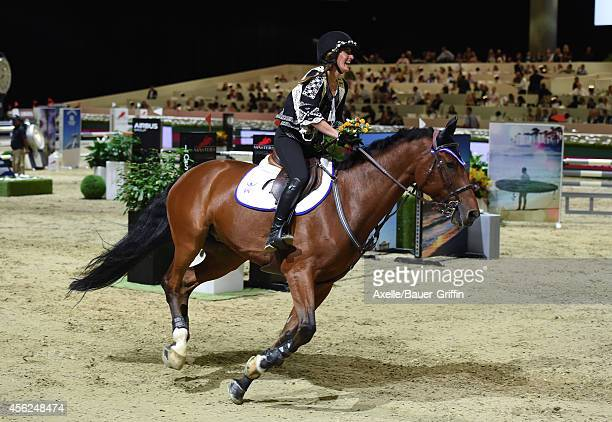 Equestrian Jessica Springsteen performs at the Longines Los Angeles Masters Charity ProAM at Los Angeles Convention Center on September 27 2014 in...