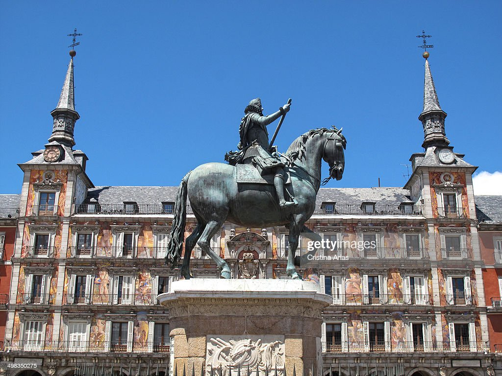 Equestrian statue of Felipe III in the center of the Plaza Mayor in Madrid designed by the Italian sculptor Giambologna and Pietro Tacca and behind...